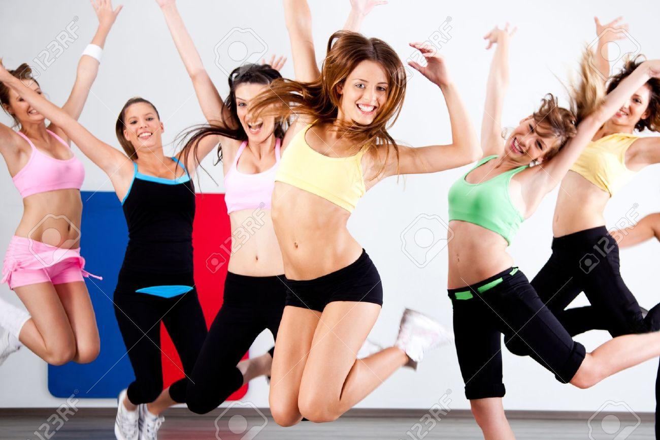 Enthusiastic group of women having fun during aerobics class. - 10473828