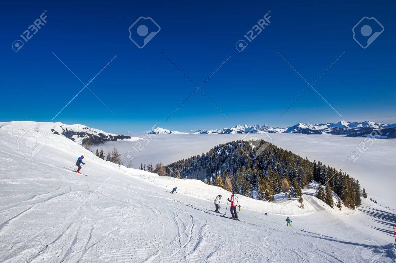 skier skiing and enjoying the view to alpine mountains in austria
