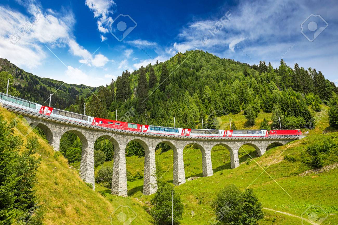 Train on famous landwasser Viaduct bridge.The Rhaetian Railway section from the Albula/Bernina area (the part from Thusis to Tirano, including St Moritz) was added to the list of UNESCO World Heritage Sites, Switzerland, Europe. - 66982356