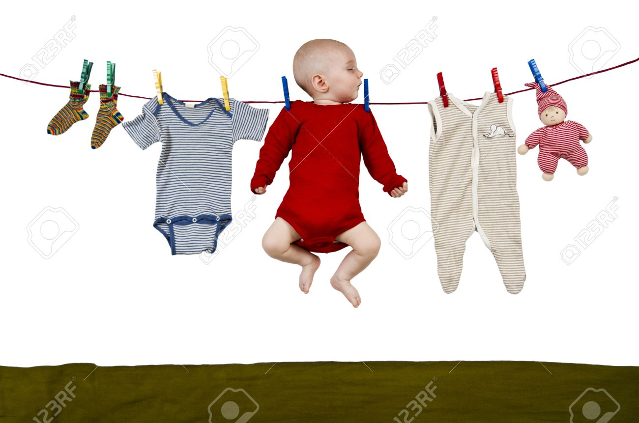 young child hanging at clothes line together with toys and clothing Stock Photo - 10782357