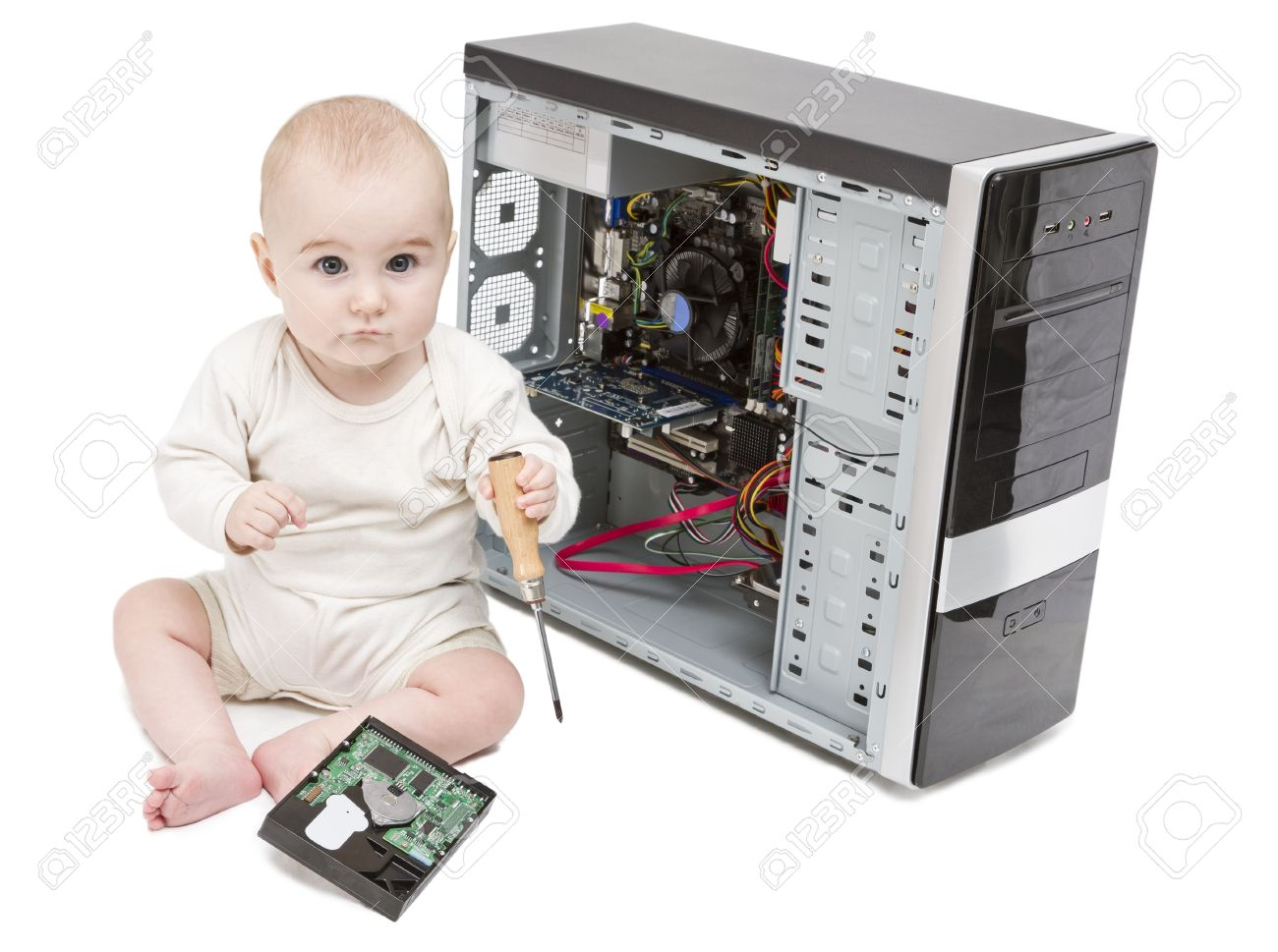 young child with screwdriver in hand working on open computer in white background. hard disk laying around Stock Photo - 11326746