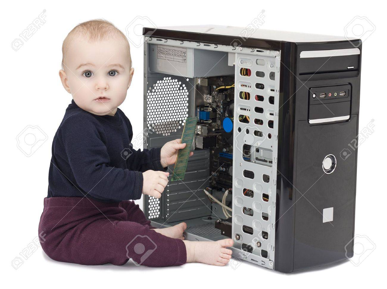 young child in blue shirt with open computer on white background Stock Photo - 11974682