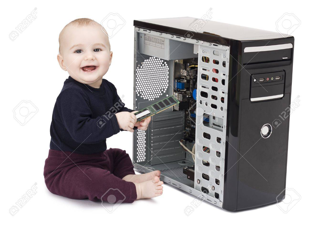 young child in blue shirt with open computer on white background Stock Photo - 11974322