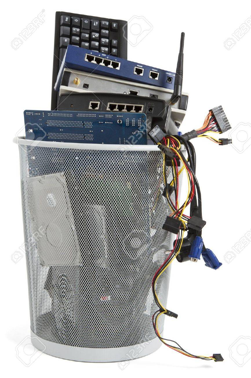 electronic scrap in trash can keyboard, power supply, router,
