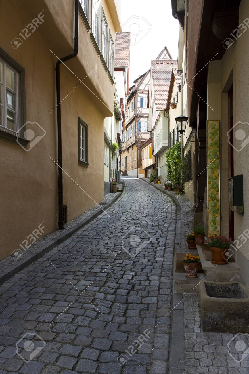 narrow lane in historic city in south west germany with bouldering Stock Photo - 13884904