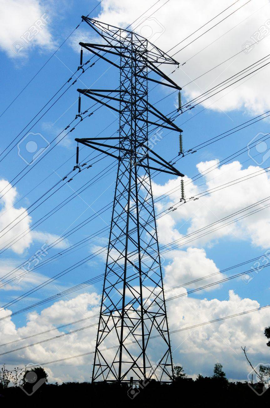 A single voltage power isolated with blue cloudy sky, and green foreground. Stock Photo - 11079893