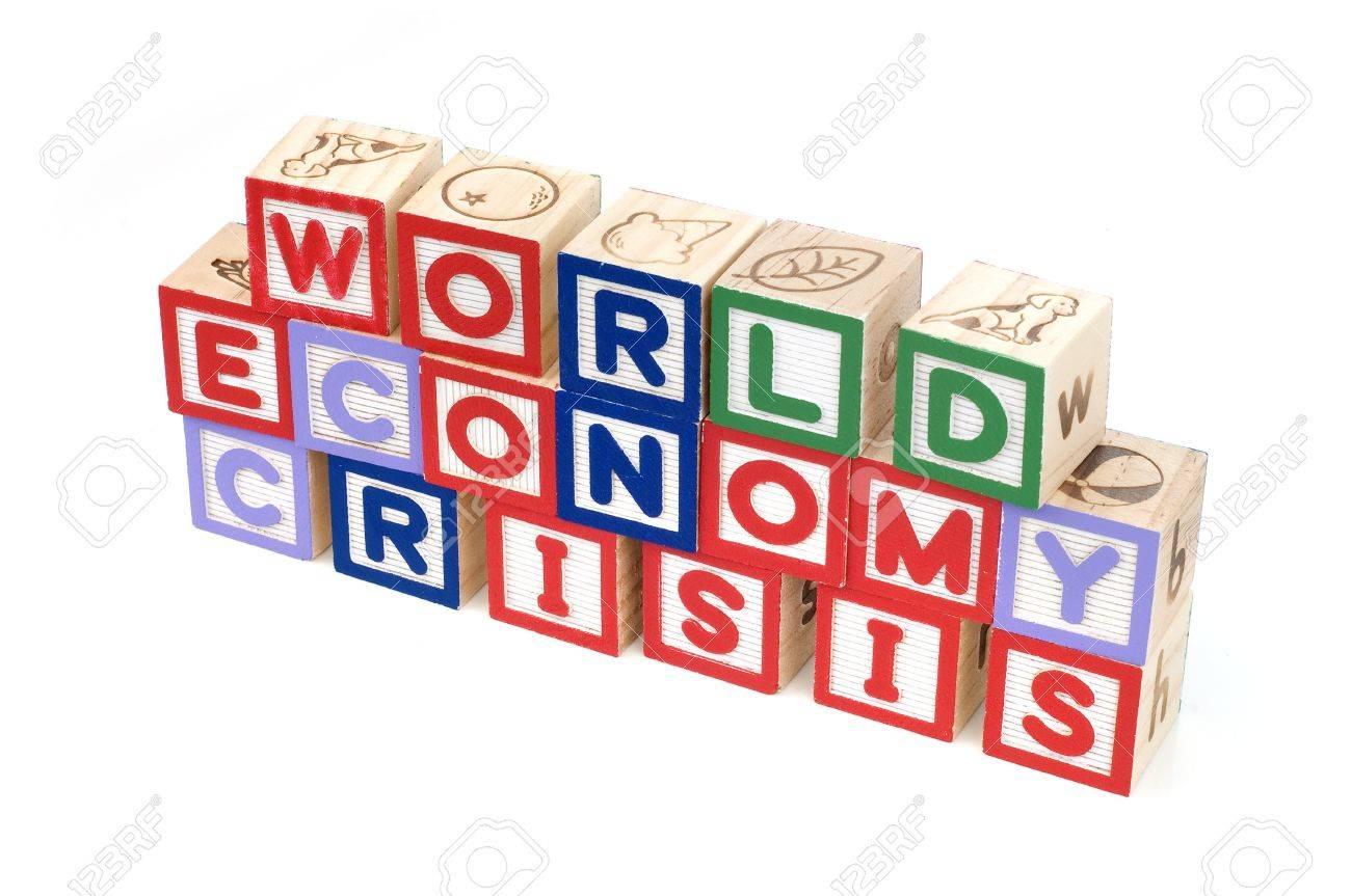 Alphabet blocks spelling World  Economy Crisis Stock Photo - 11820018