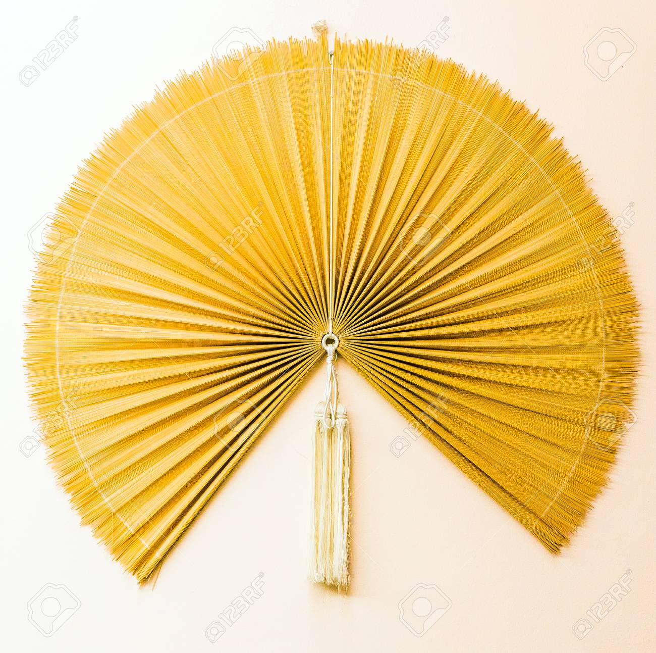 Decorative Vietnamese Fan On The Wall In Hanoi, Vietnam. Close-up ...