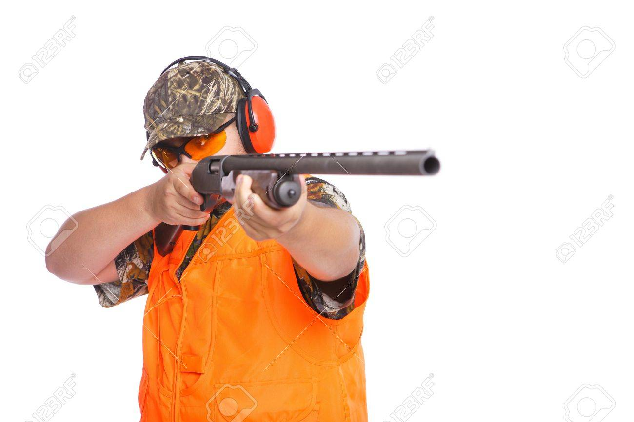 Hunter pointing shotgun at right side of the camera, isolated on white. Stock Photo - 7853127