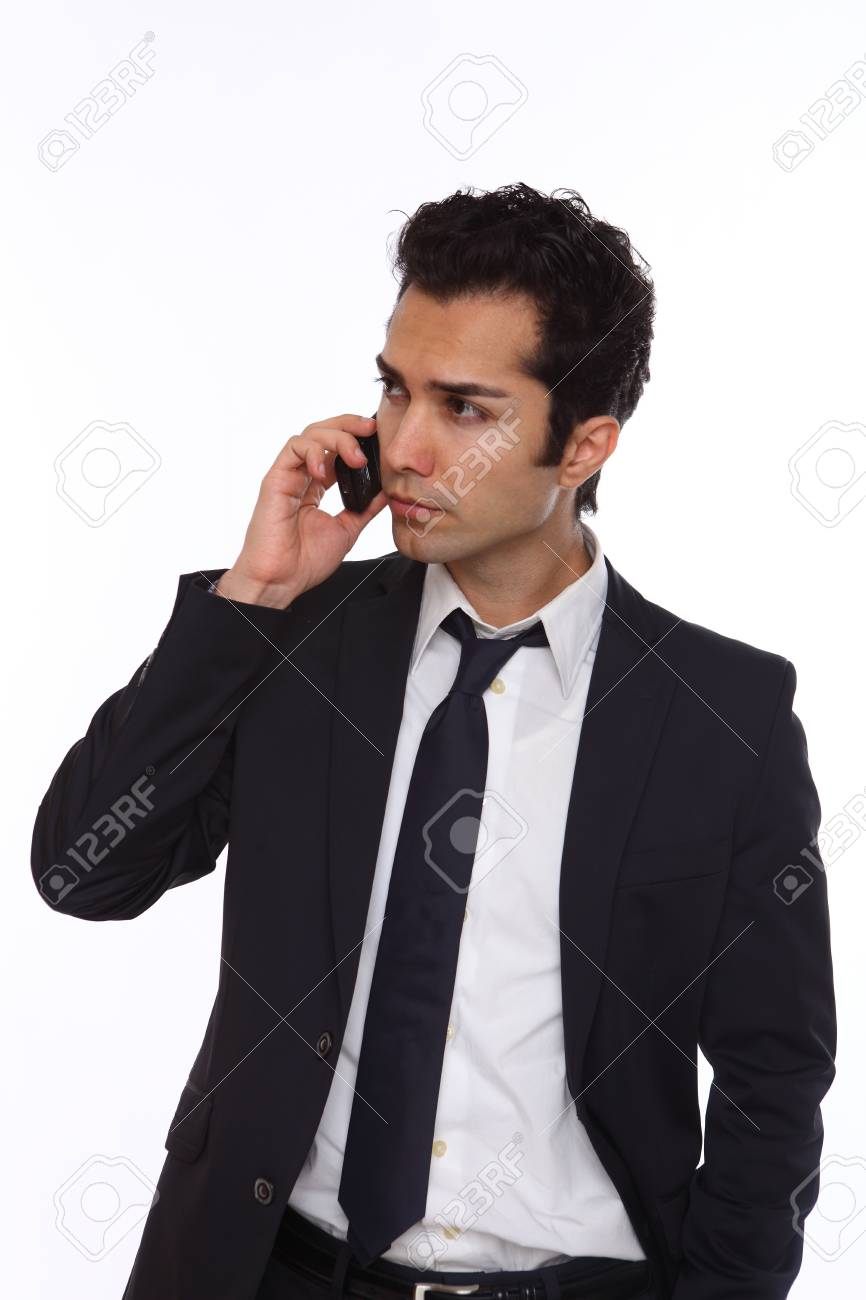 Businessman in a suit talking on his wireless phone Stock Photo - 19641983