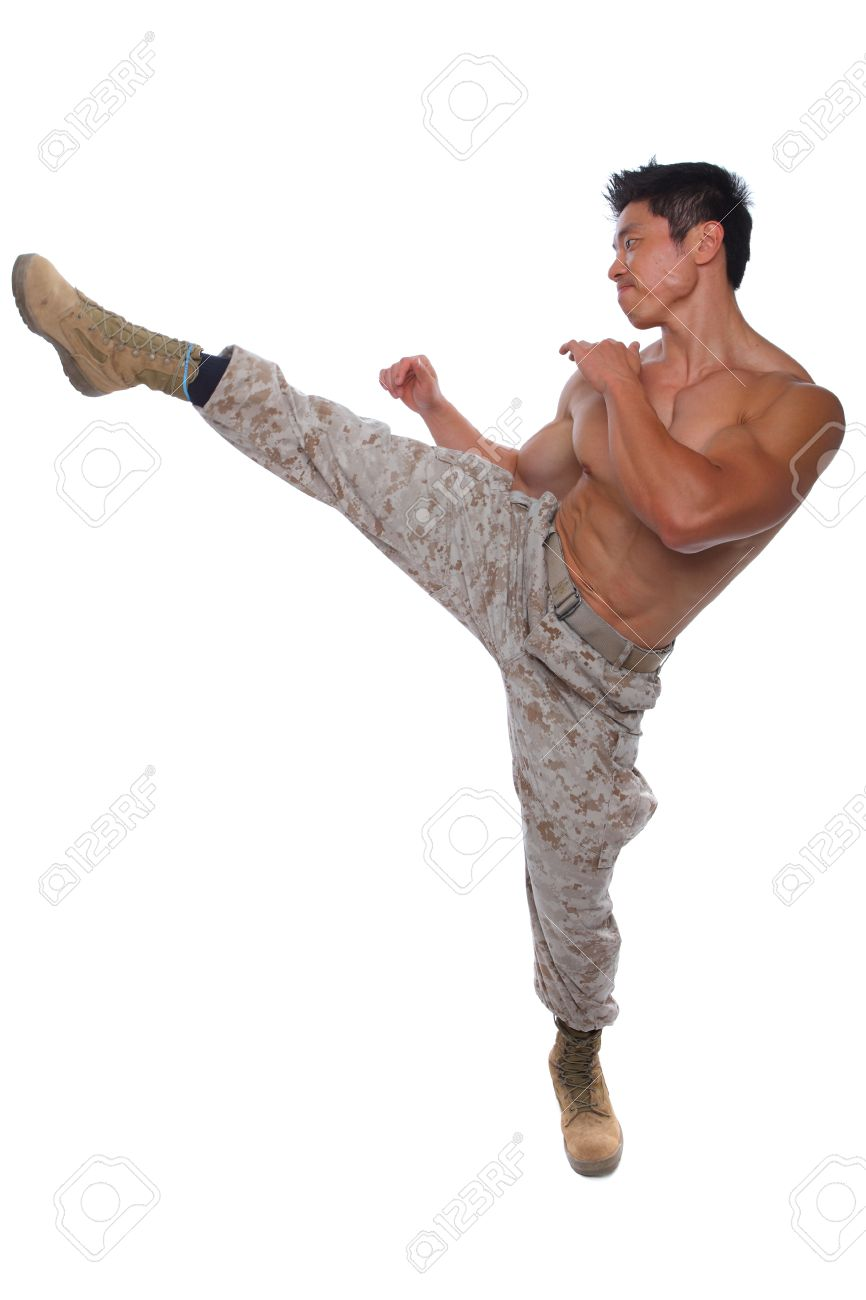 muscular marine high kick in uniform isolated on white stock photo