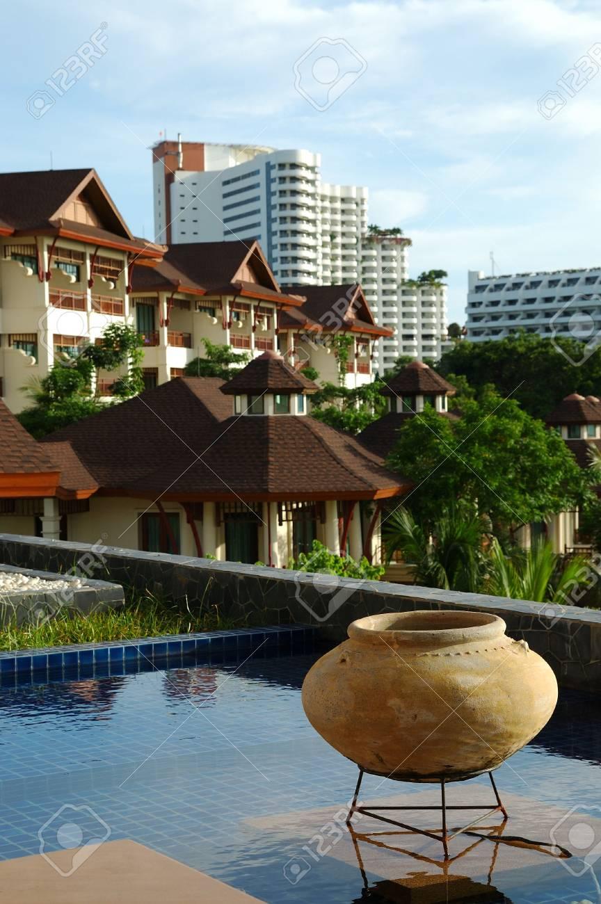 Buildings reflecting in resort's pool Stock Photo - 3369704