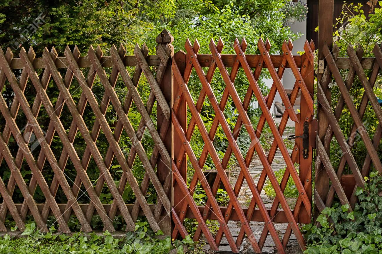 Wooden Lattice Grid Fence. Garden Entrance Stock Photo, Picture And ...