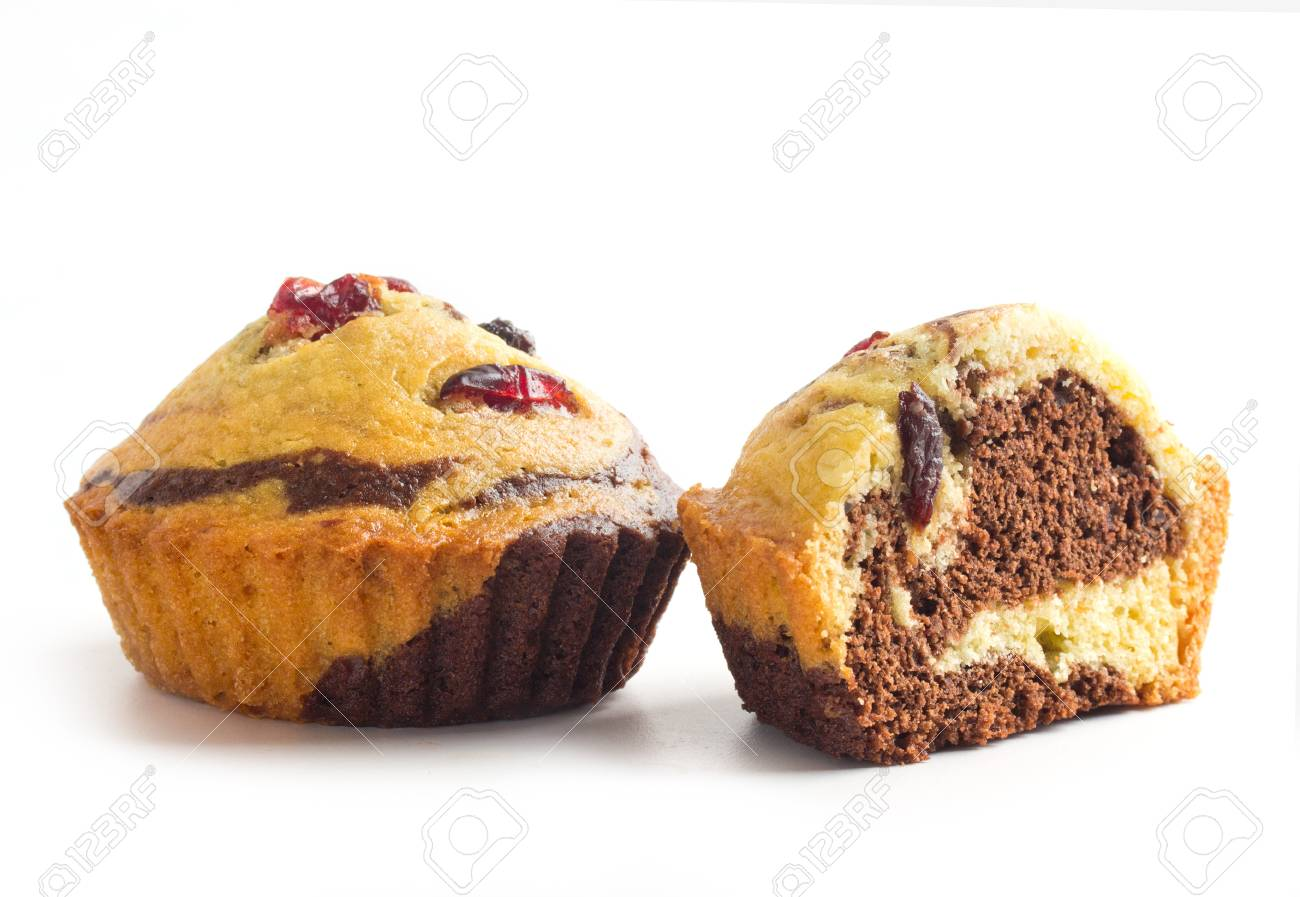 two cupcakes with guelder-rose berry and raisin on white Stock Photo - 17452747