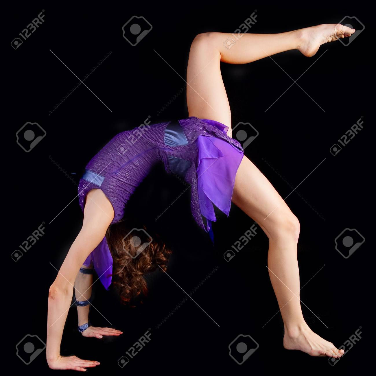 young yoga female doing yogatic exericise . Black background Stock Photo - 5865628