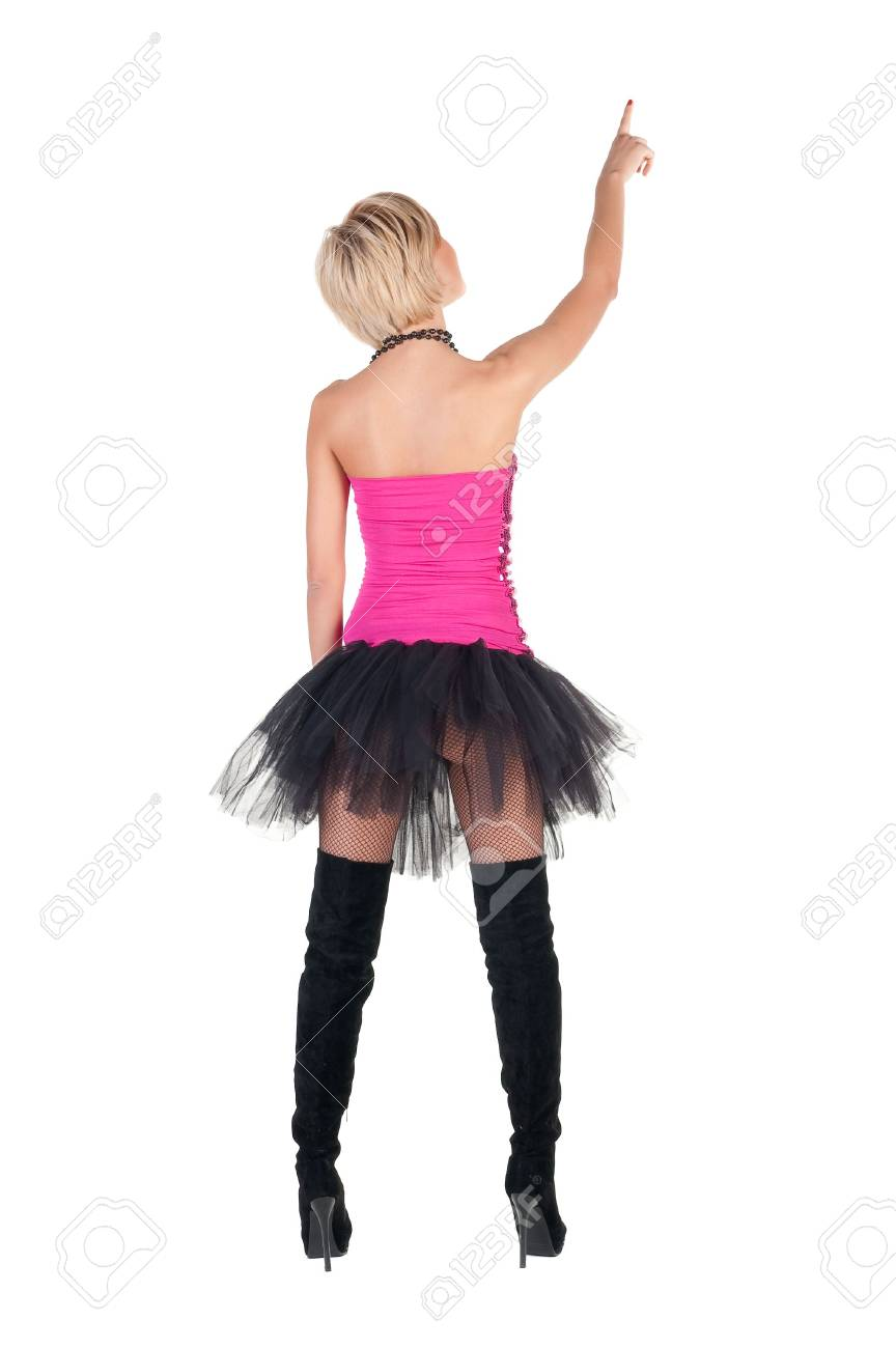 Extravagant blonde in  crown pointing. Rear view . Stock Photo - 6711134