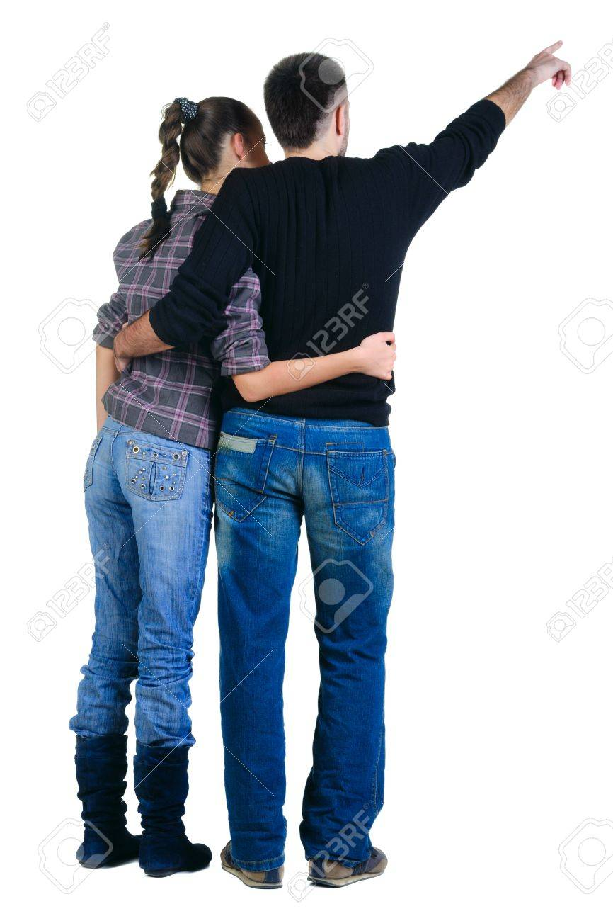 Young couple pointing at wall. Rear view. Isolated over white background. Stock Photo - 8599439