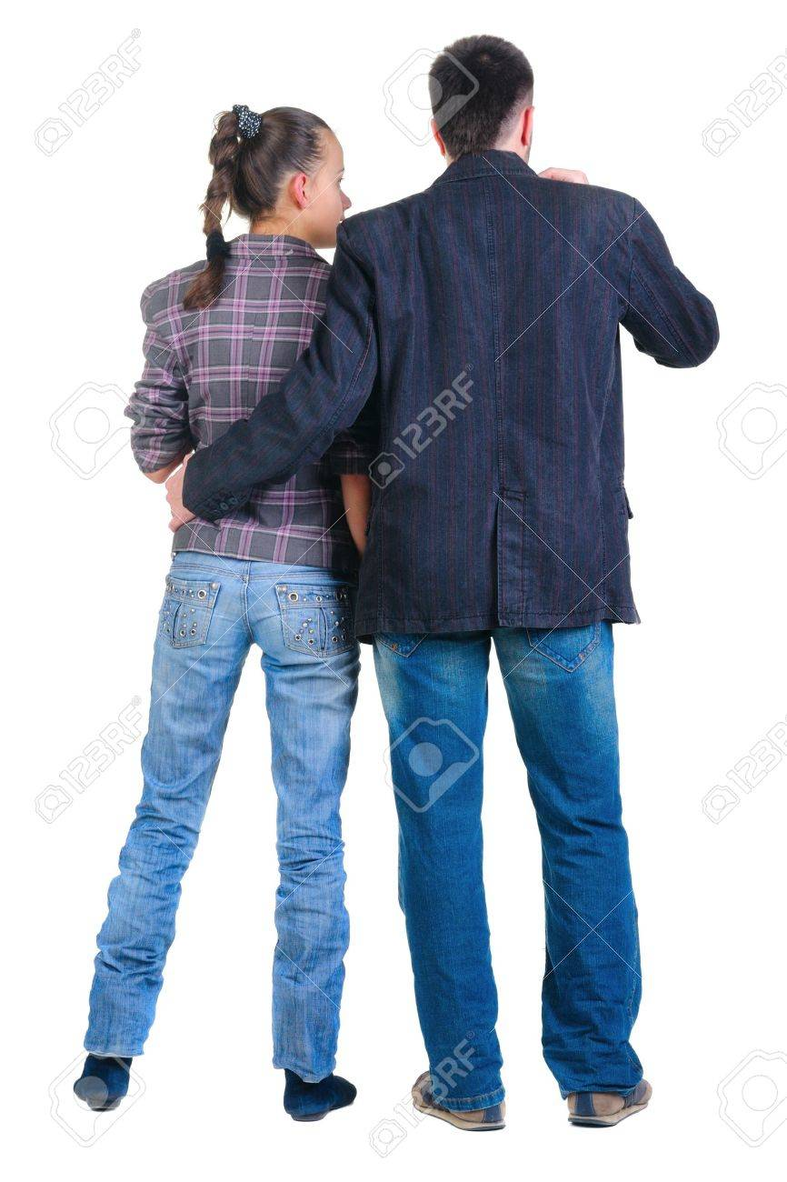 Young couple looks where that. Rear view. Isolated over white. Stock Photo - 8599436