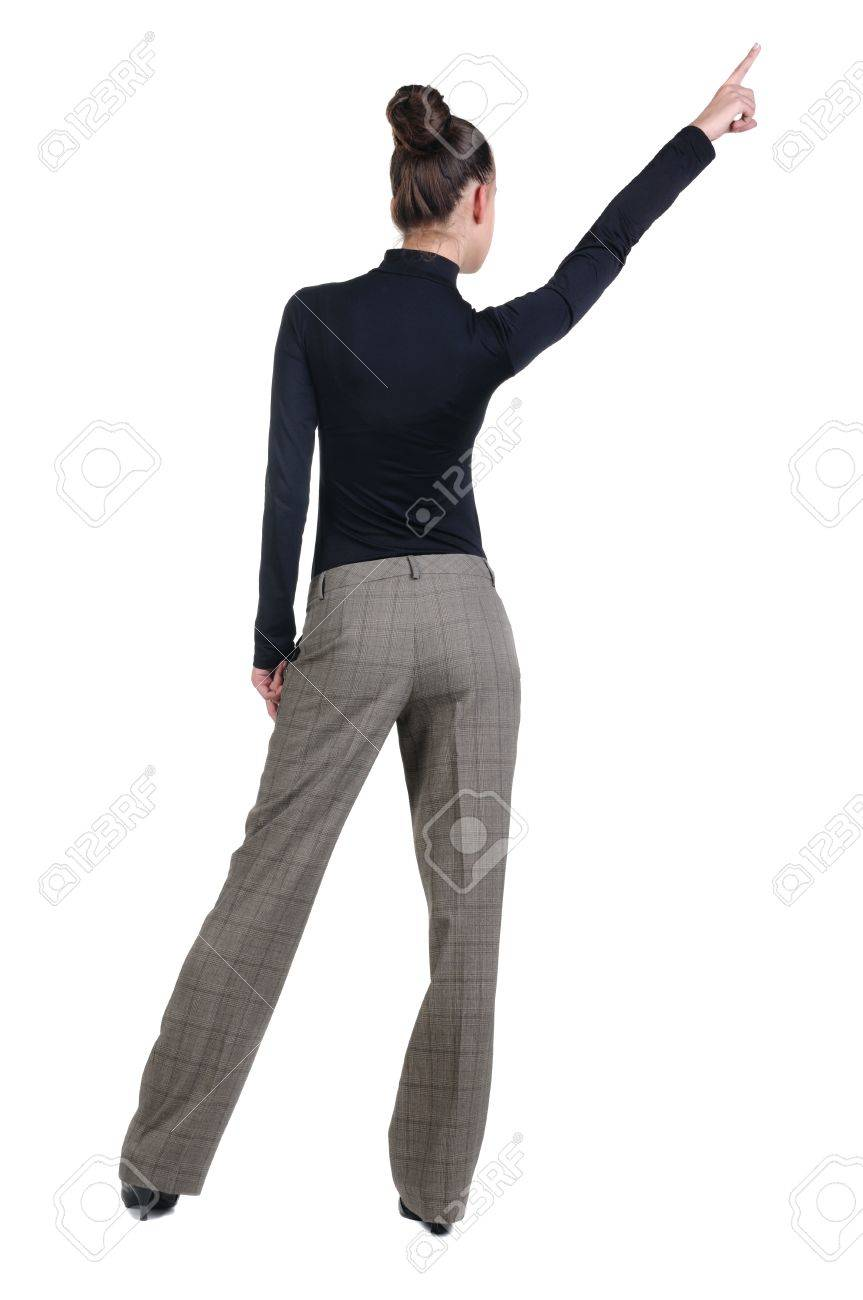 Beautiful young woman pointing at wall. Rear view. Isolated over white backrgound. Stock Photo - 8599376