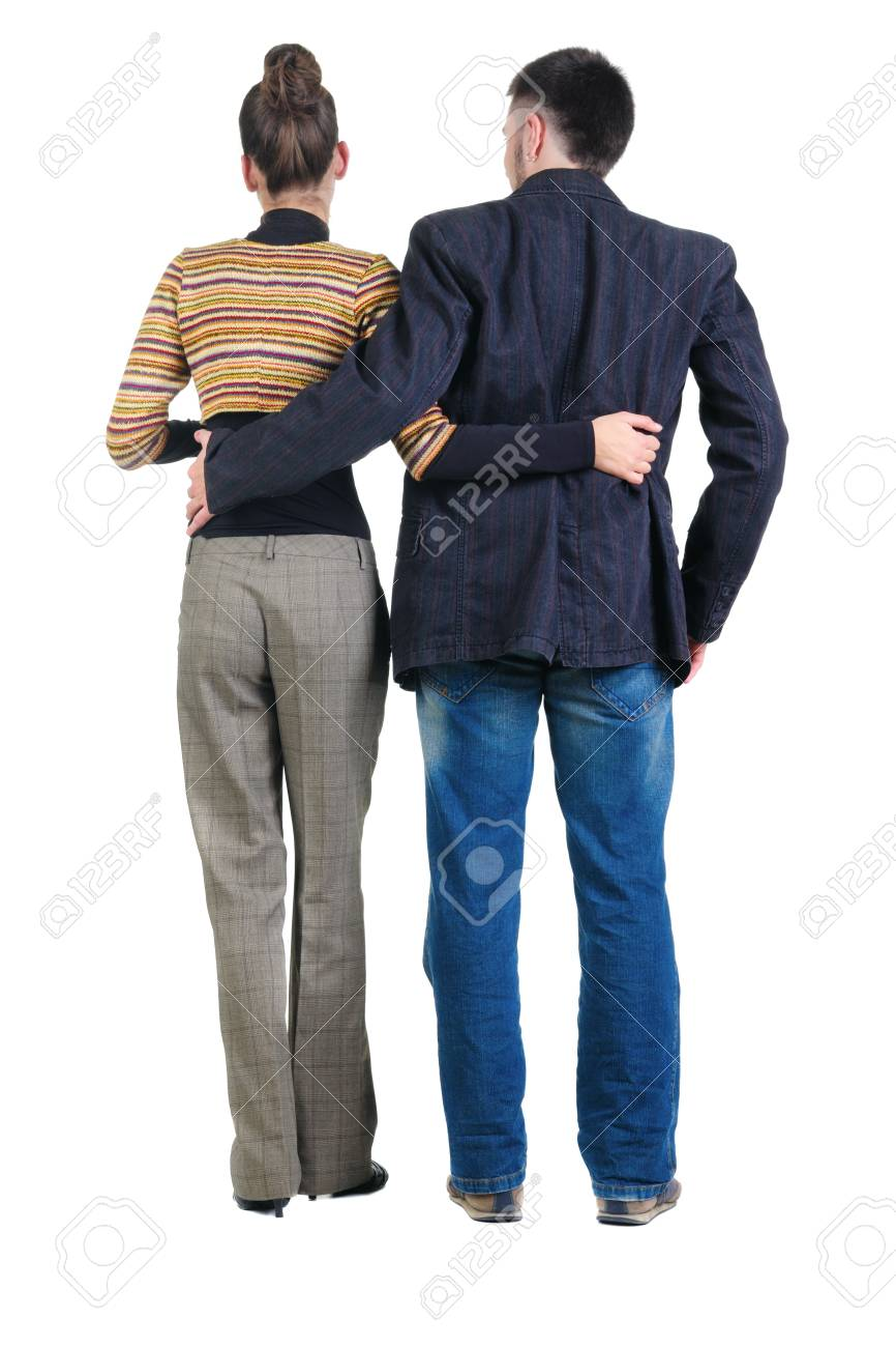 Young couple looks where that. Rear view. Isolated over white. Stock Photo - 8665533