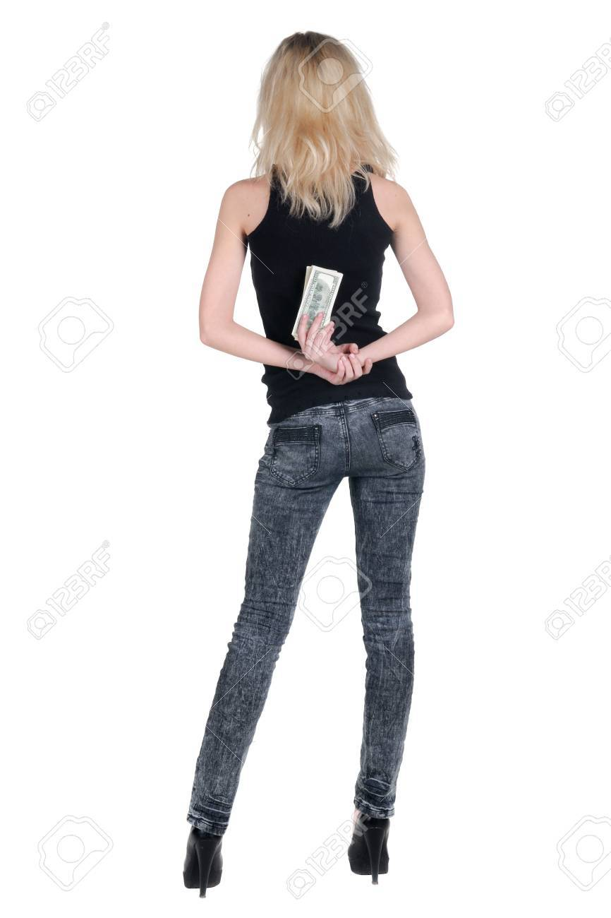 Beautiful young woman with money. Rear view. Stock Photo - 9258371