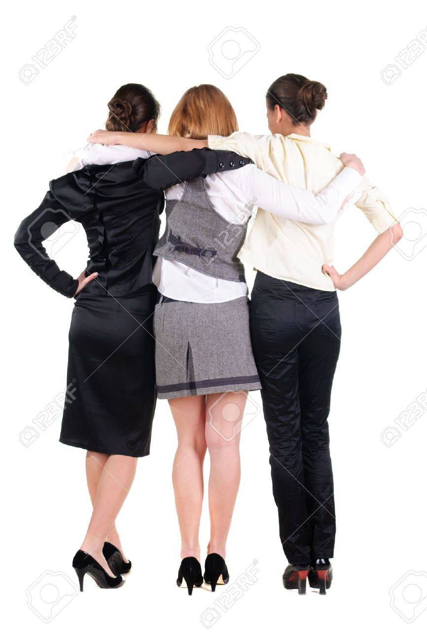 three beautiful young bussineswoman looking at wall. Rear view. Isolated over white. Stock Photo - 10002291