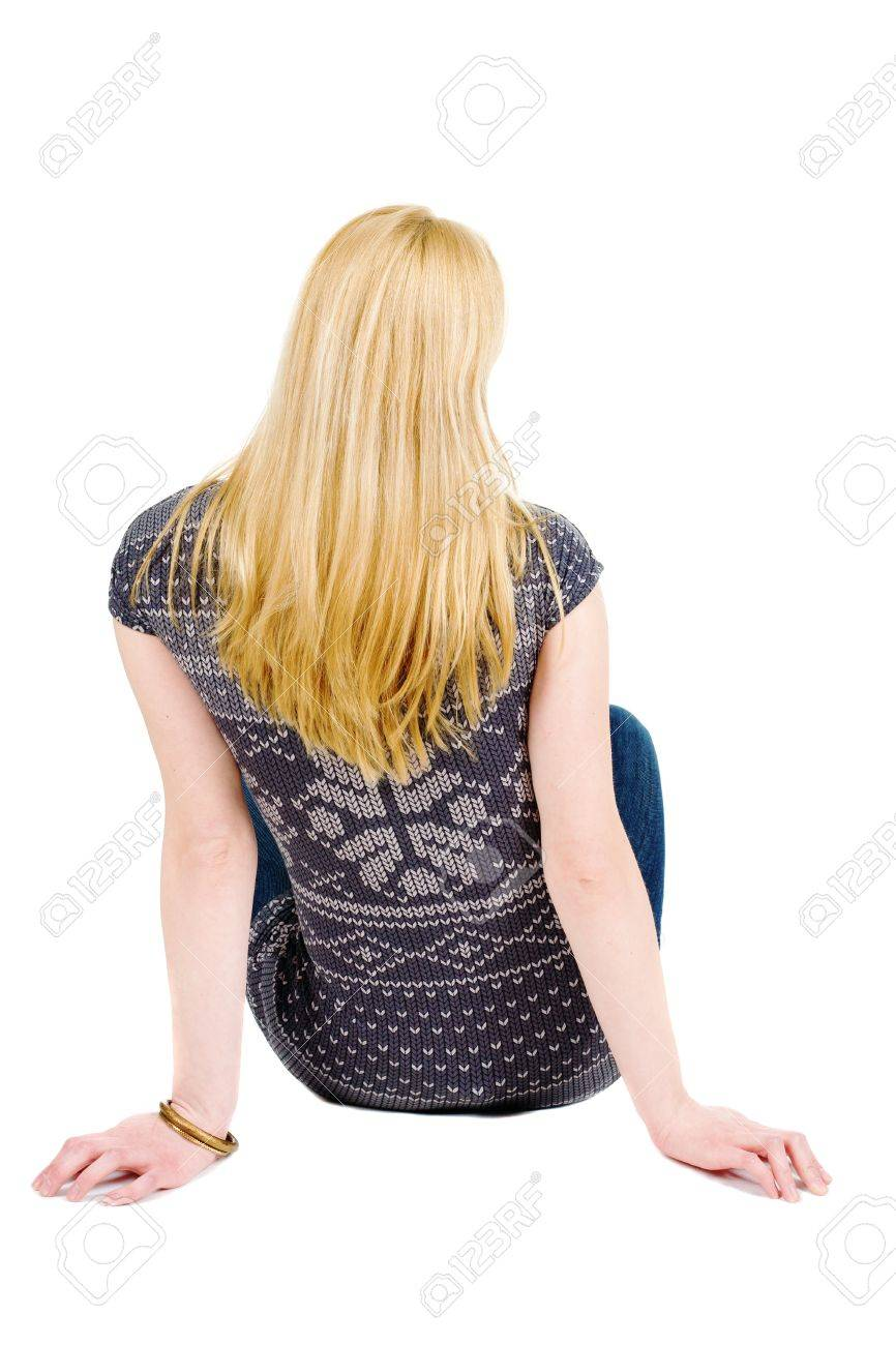 Back view of beautiful woman relaxes and looks into the distance. Blonde young girl sitting. Rear view people. Isolated over white background. Stock Photo - 13148276