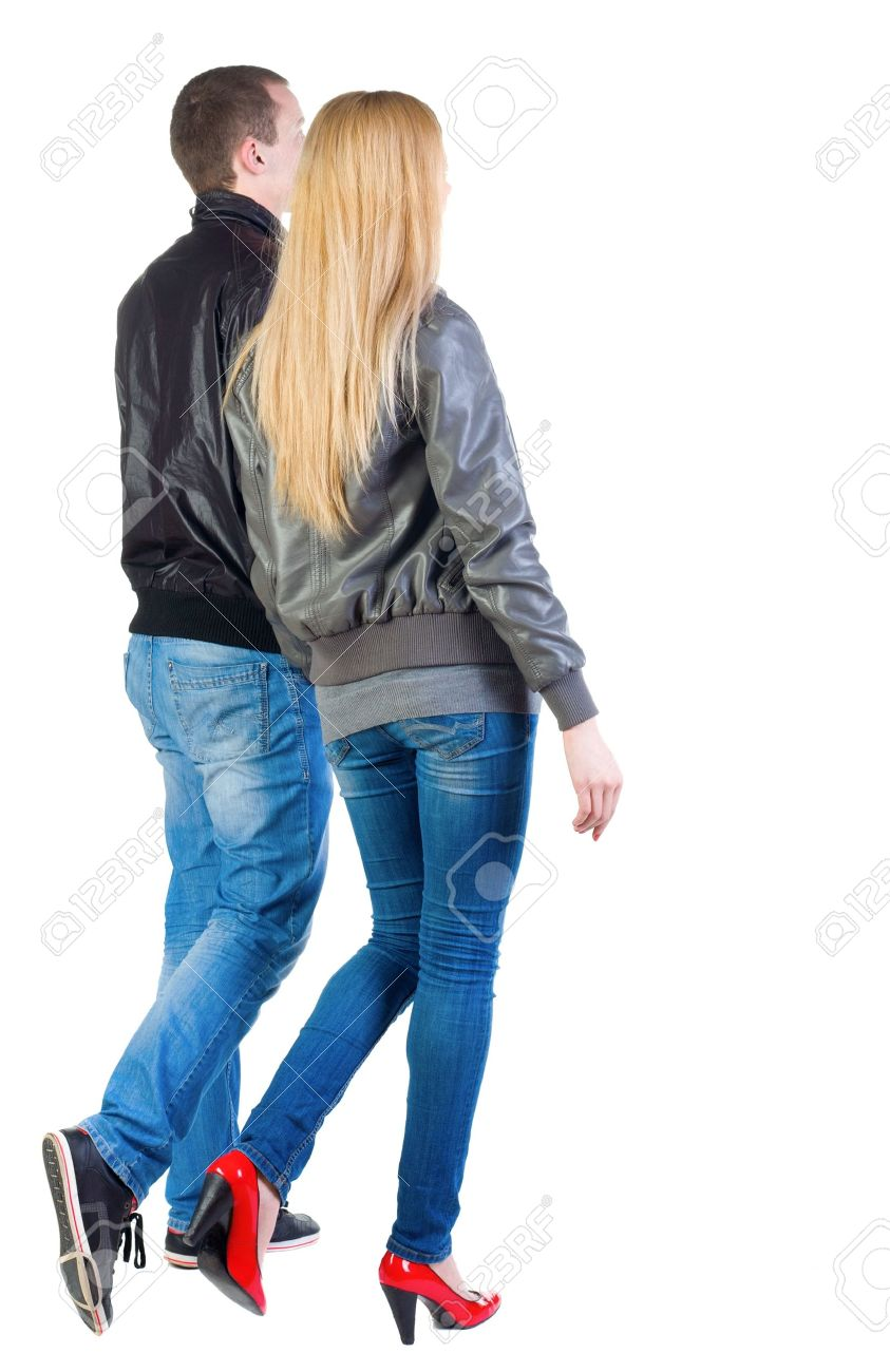 Back view of going young couple (man and woman) . walking beautiful friendly girl and guy in jacket and jeans together. Rear view people collection.  backside view of person.  Isolated over white background. Stock Photo - 13570049