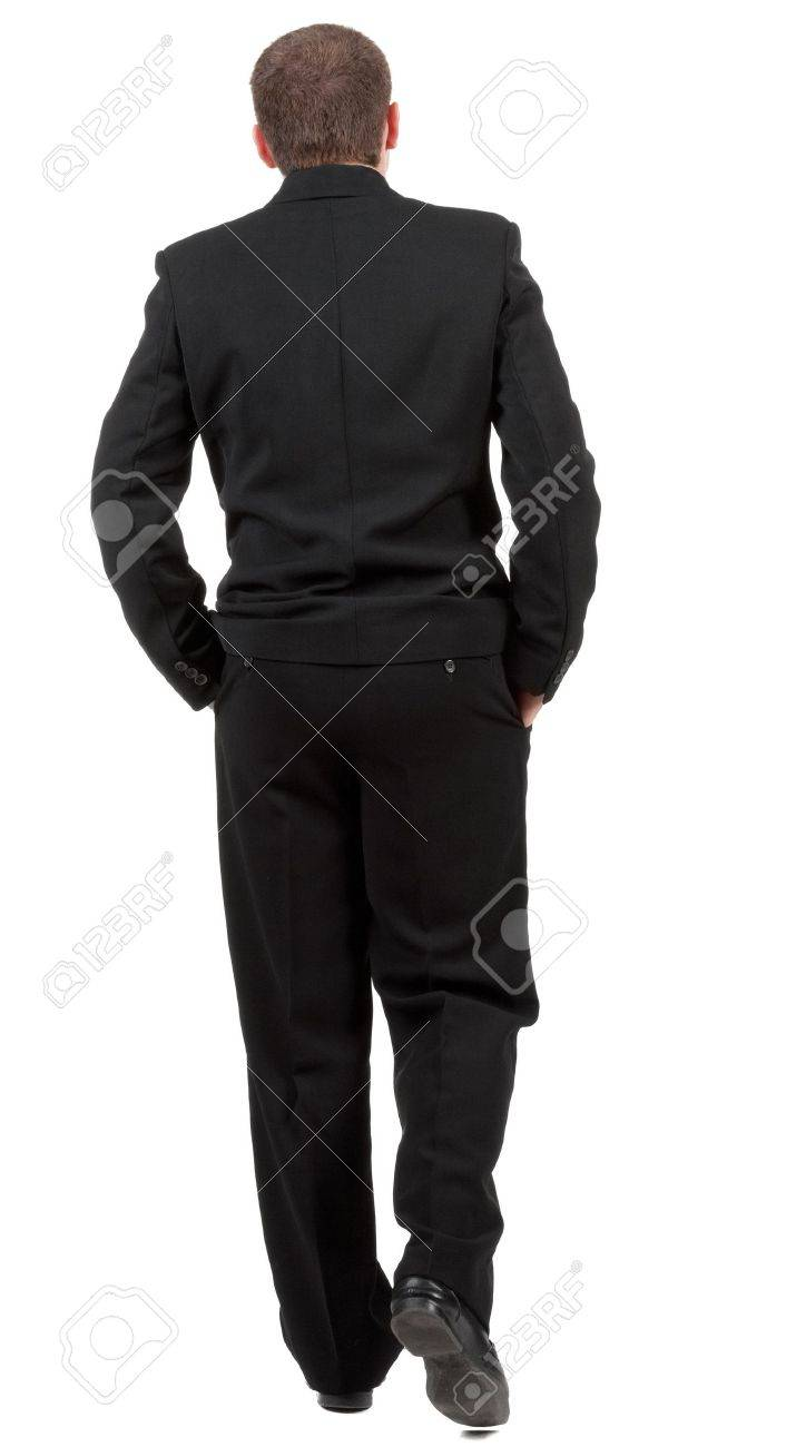 back view of walking business man.  going young guy in black suit. Stock Photo - 13664060