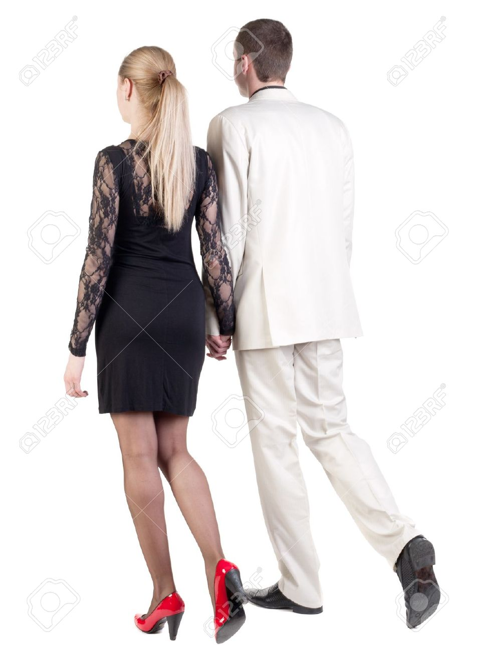 Back view of going young business couple (man and woman) . walking beautiful friendly girl in dress and guy in suit. Rear view people collection.  backside view of person.  Isolated over white background. Stock Photo - 13772973