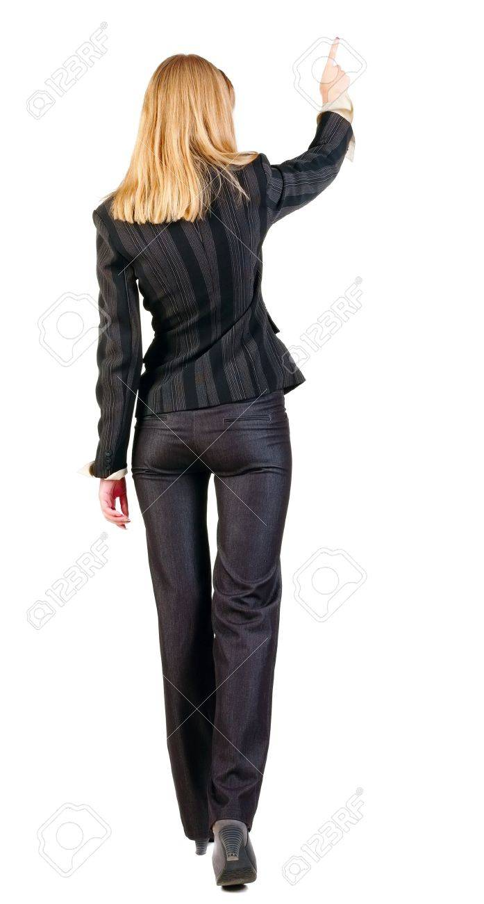 back view of walking business woman.  pointing young girl in black suit. Rear view people collection.  backside view of person.  Isolated over white background. Stock Photo - 13828425