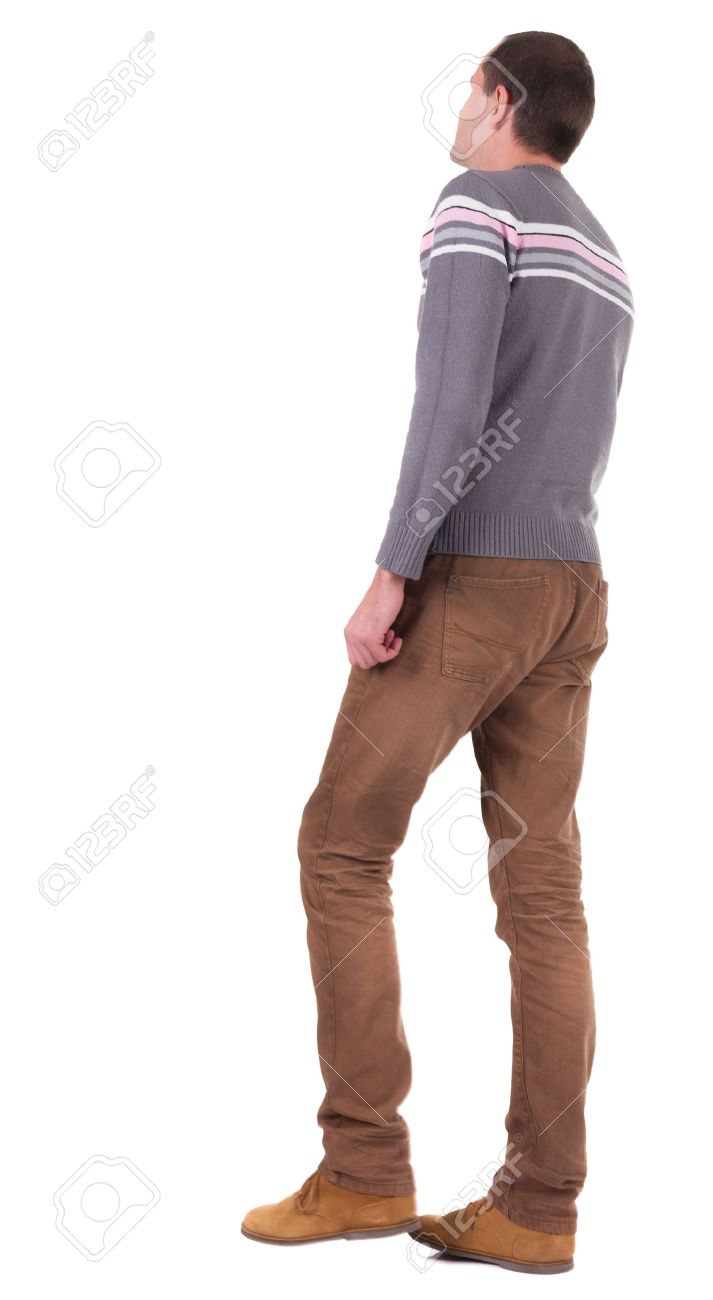 back view of going man in brown jeans and shoes walking stock