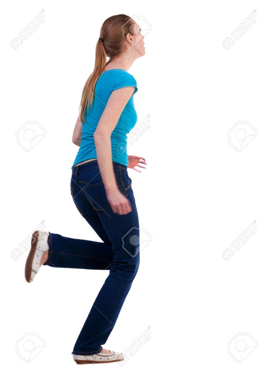 back view of running  woman  in  jeans. beautiful blonde girl in motion.  backside view of person.  Rear view people collection. Isolated over white background. Stock Photo - 18421364