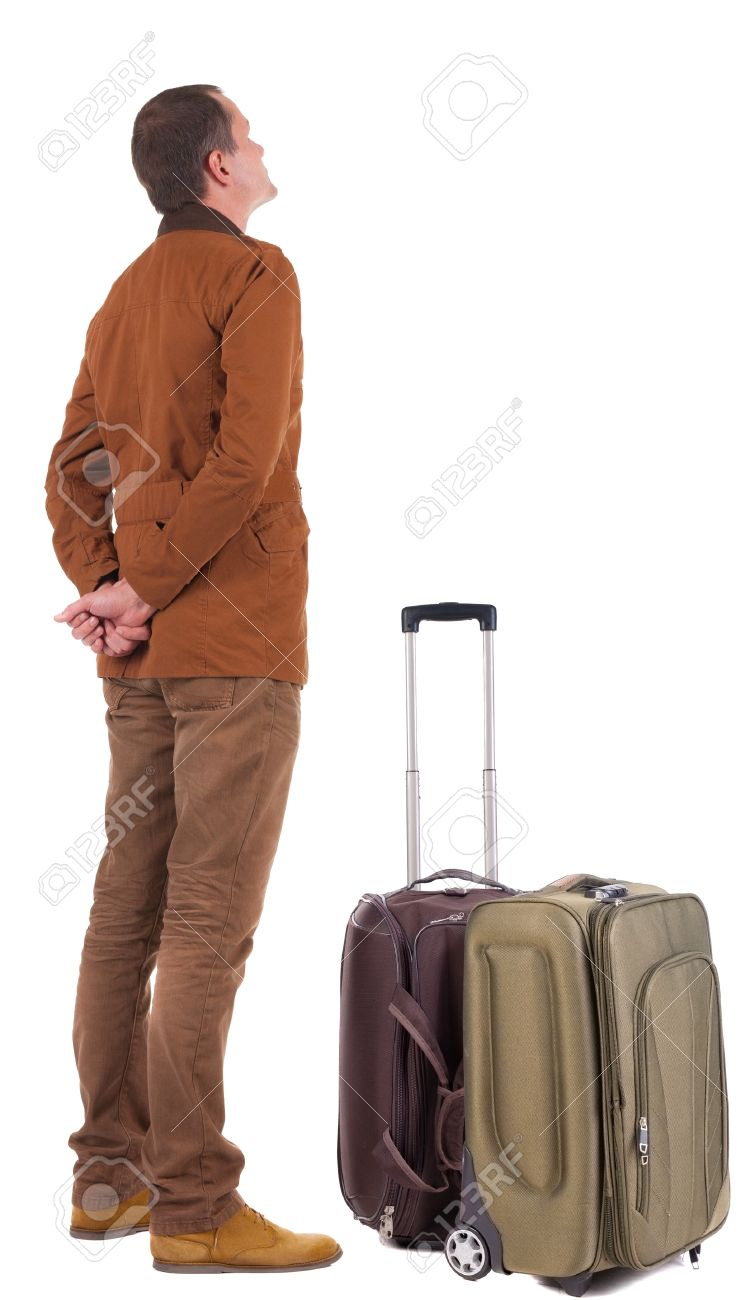 Back view of traveling busness man with  suitcase looking up. Standing young guy in jeans and  jacket.   Isolated over white background. Stock Photo - 20575707