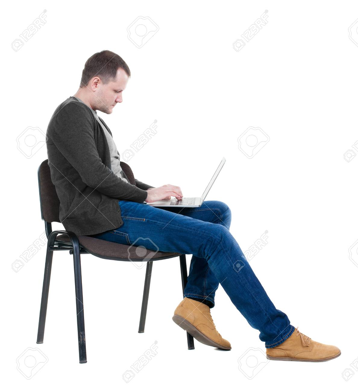 Wondrous Side View Of A Man Sitting On A Chair To Study With A Laptop Caraccident5 Cool Chair Designs And Ideas Caraccident5Info