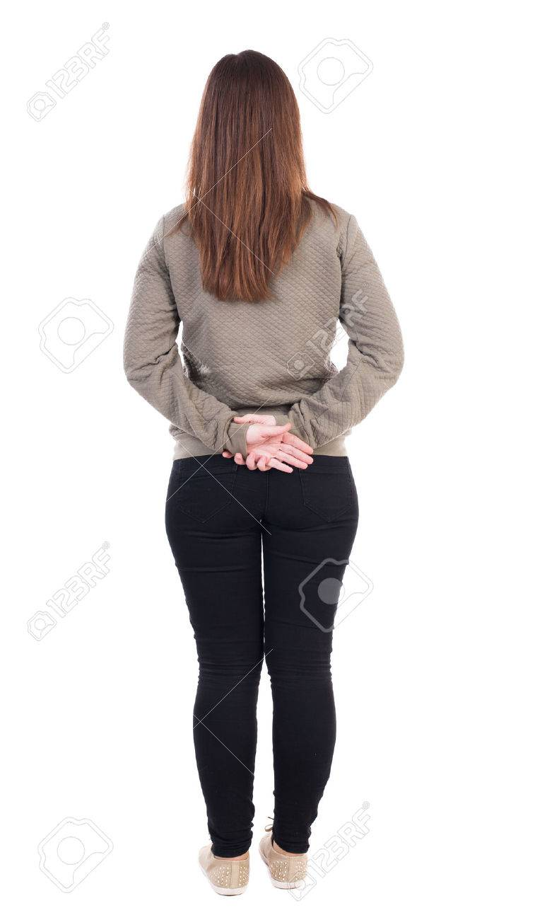 back view of standing young beautiful woman. girl watching. Rear view people collection. backside view of person. Isolated over white background. Girl standing with hands clasped behind his back. - 39698267