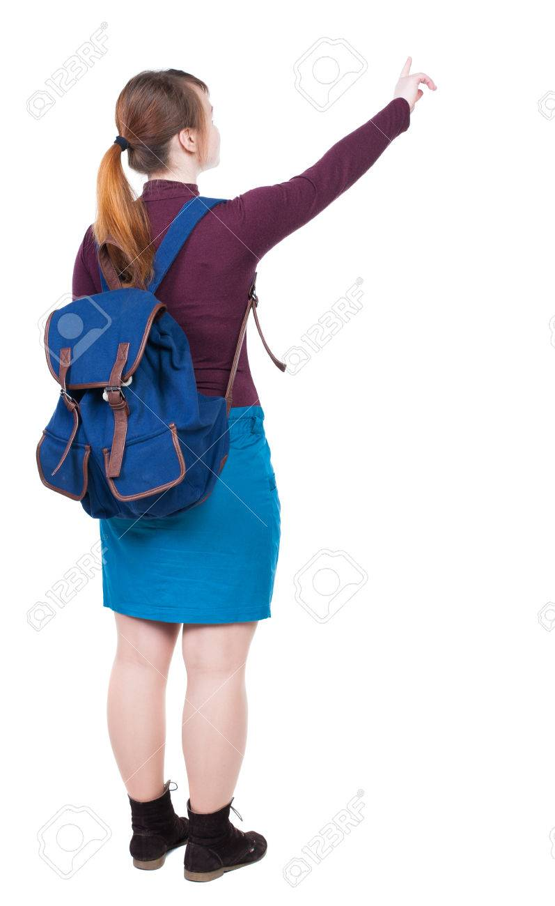 788fb11b03 Back view of pointing woman with backpack looking up. Standing young girl. Rear  view people collection. backside view of person.