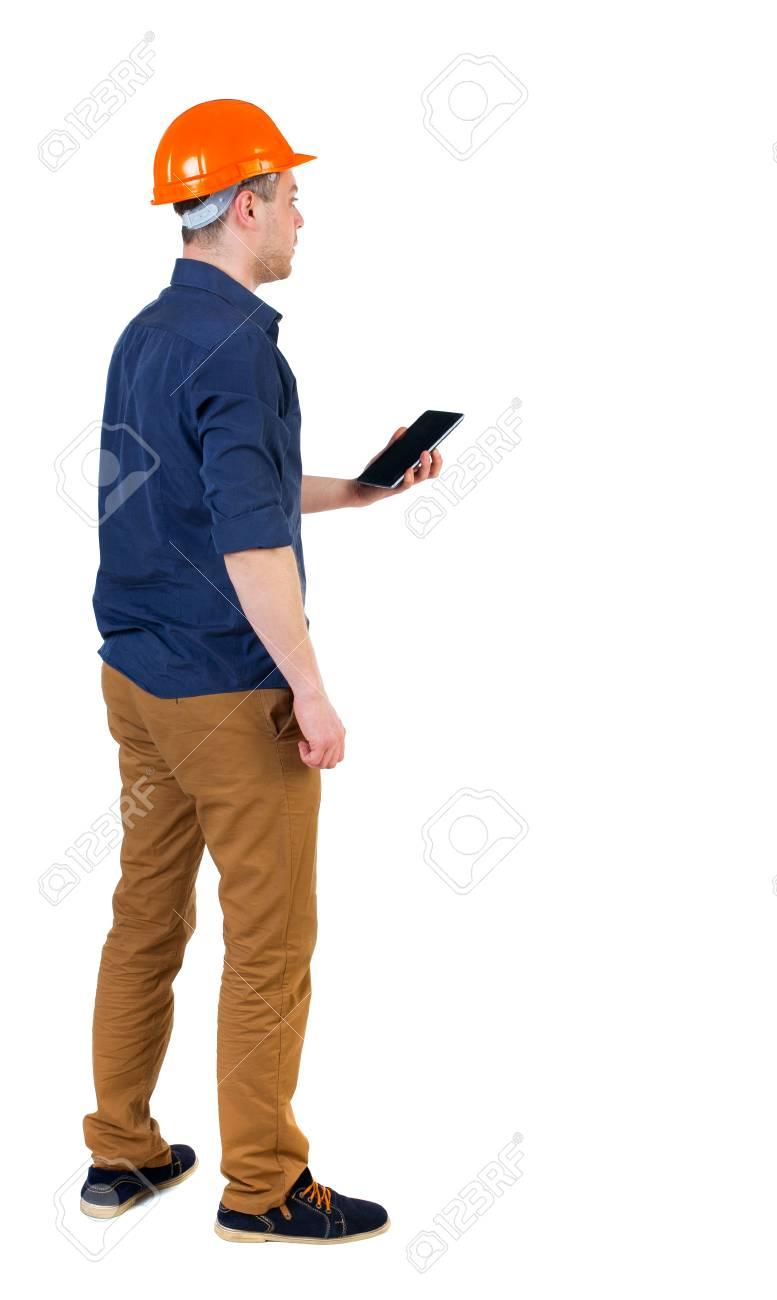 backview ヘルメットのビジネスマン達の略で タブレットや携帯電話を