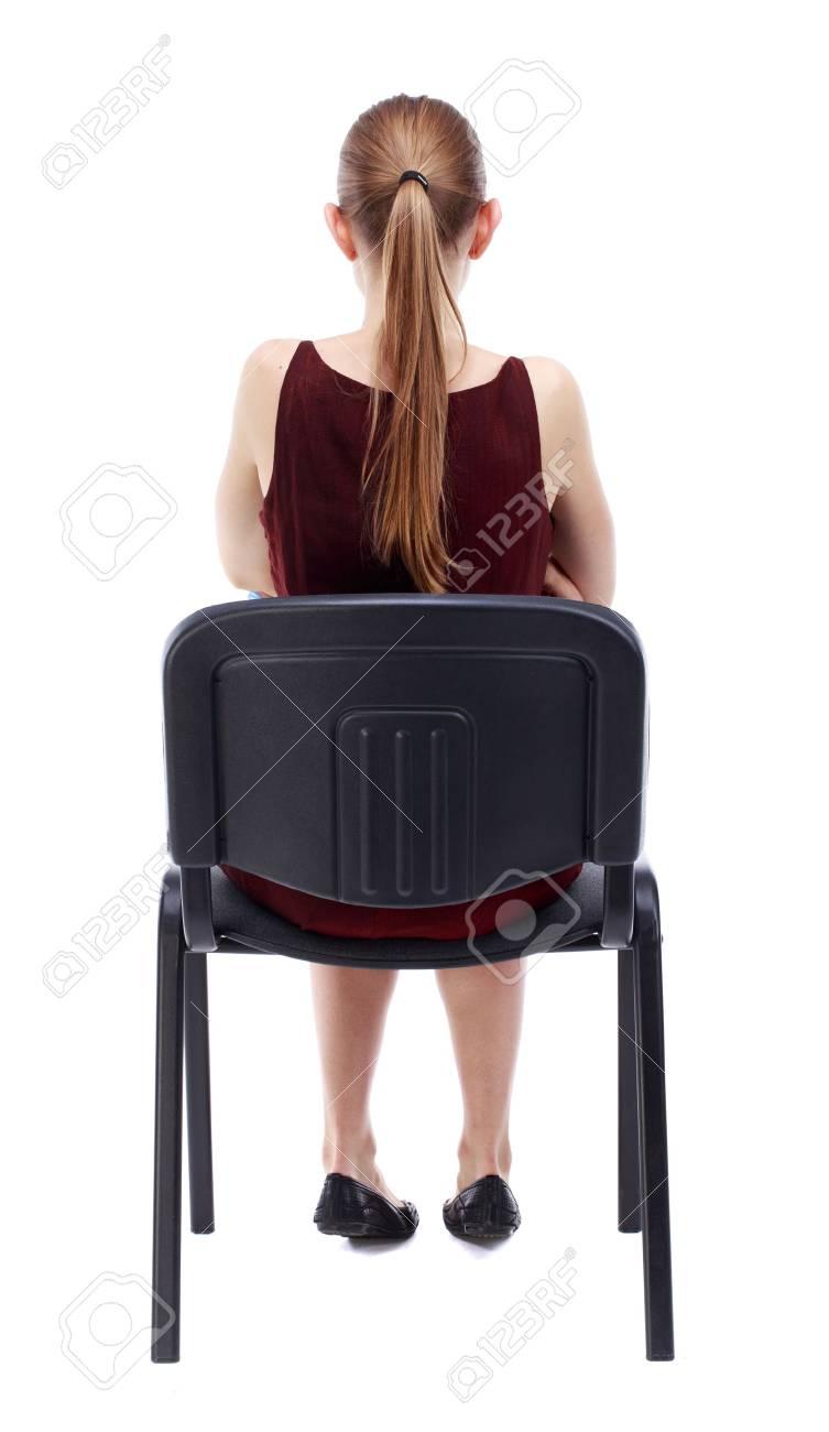 Vue De Dos La Belle Jeune Femme Assise Sur Une Chaise Fille A Regarder Arriere Collection Personnes Backside Personne