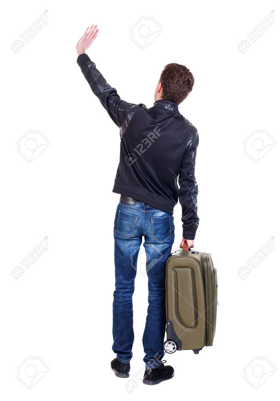 Back view of man with green suitcase man greeting waving from back view of man with green suitcase man greeting waving from his hands traveler is kristyandbryce Gallery