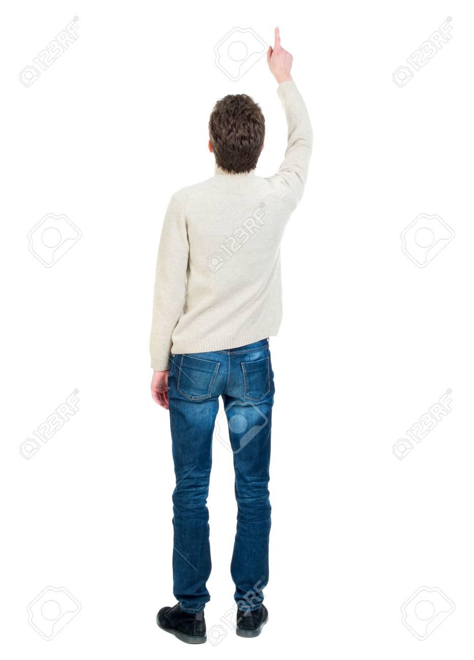 comprare popolare 3bc17 0392b Vista posteriore di indicare l'uomo d'affari. Il ragazzo riccio dai capelli  corti in una giacca bianca ha visto qualcosa in cima.