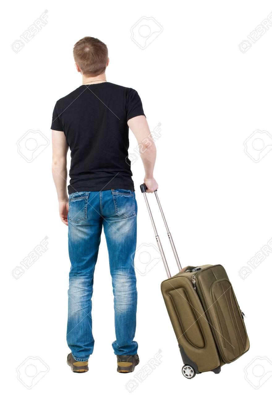 見上げる緑のスーツケースを持った男の後ろ姿 の写真素材画像素材