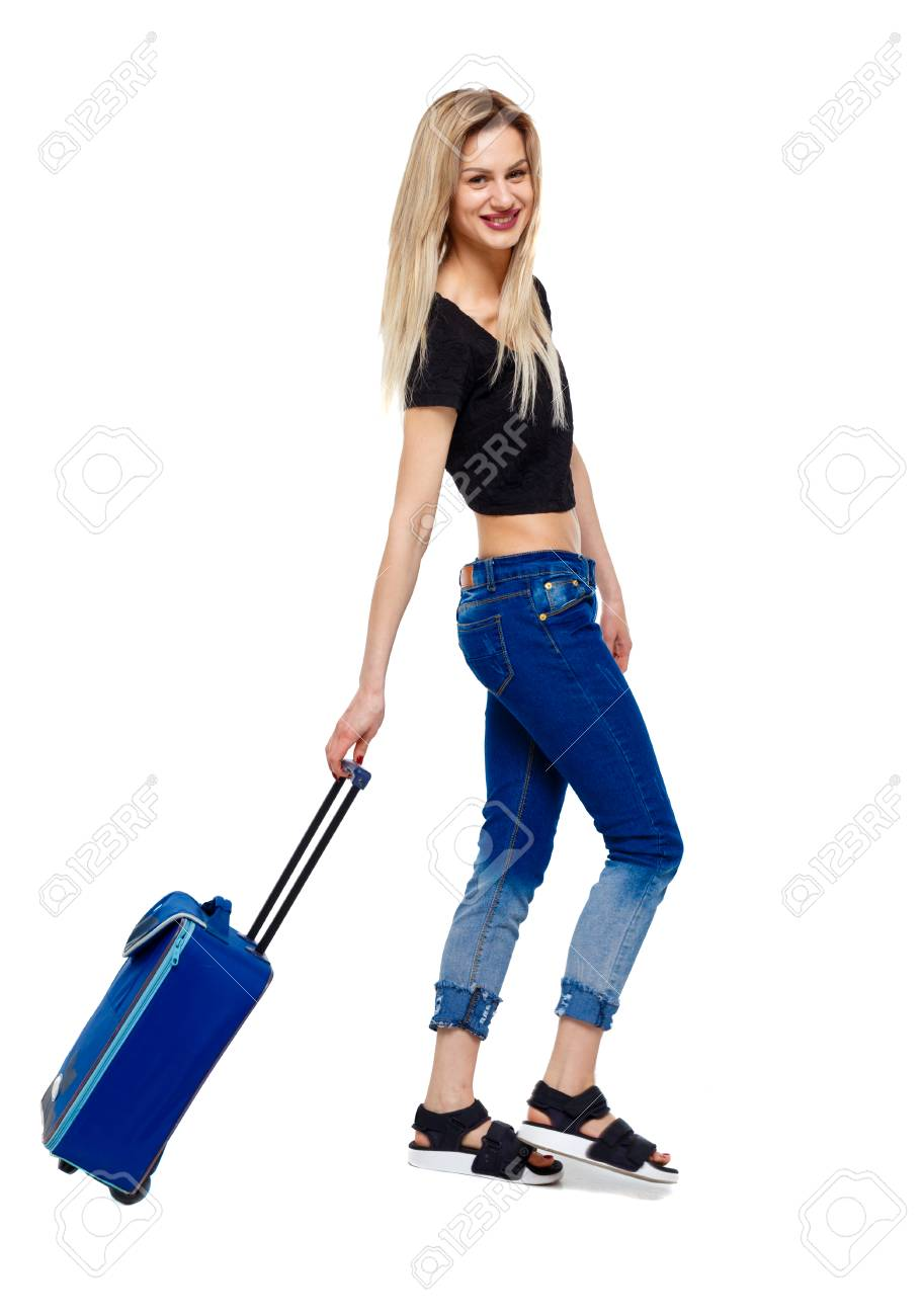 Side view of walking woman with suitcase. girl in motion. backside view of person. Rear view people collection. Isolated over white background. Happy blonde rolls a suitcase. - 121741928