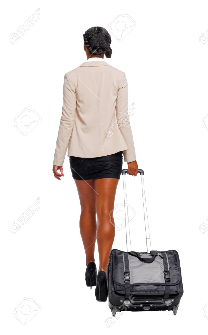 Back view of black African-American in formal attire walking with a suitcase. business woman in motion. backside view of person. Rear view people collection. Isolated over white background. - 121745826