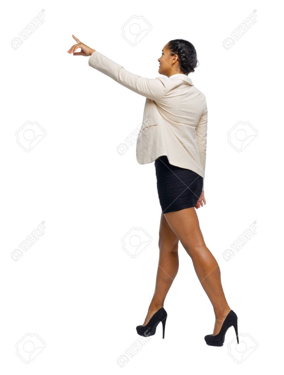 Side view of a black African-American in a suit that goes and points with his hand. backside view of person. Rear view people collection. Isolated over white background. business woman in high heels shoes goes showing hand up. - 125722765