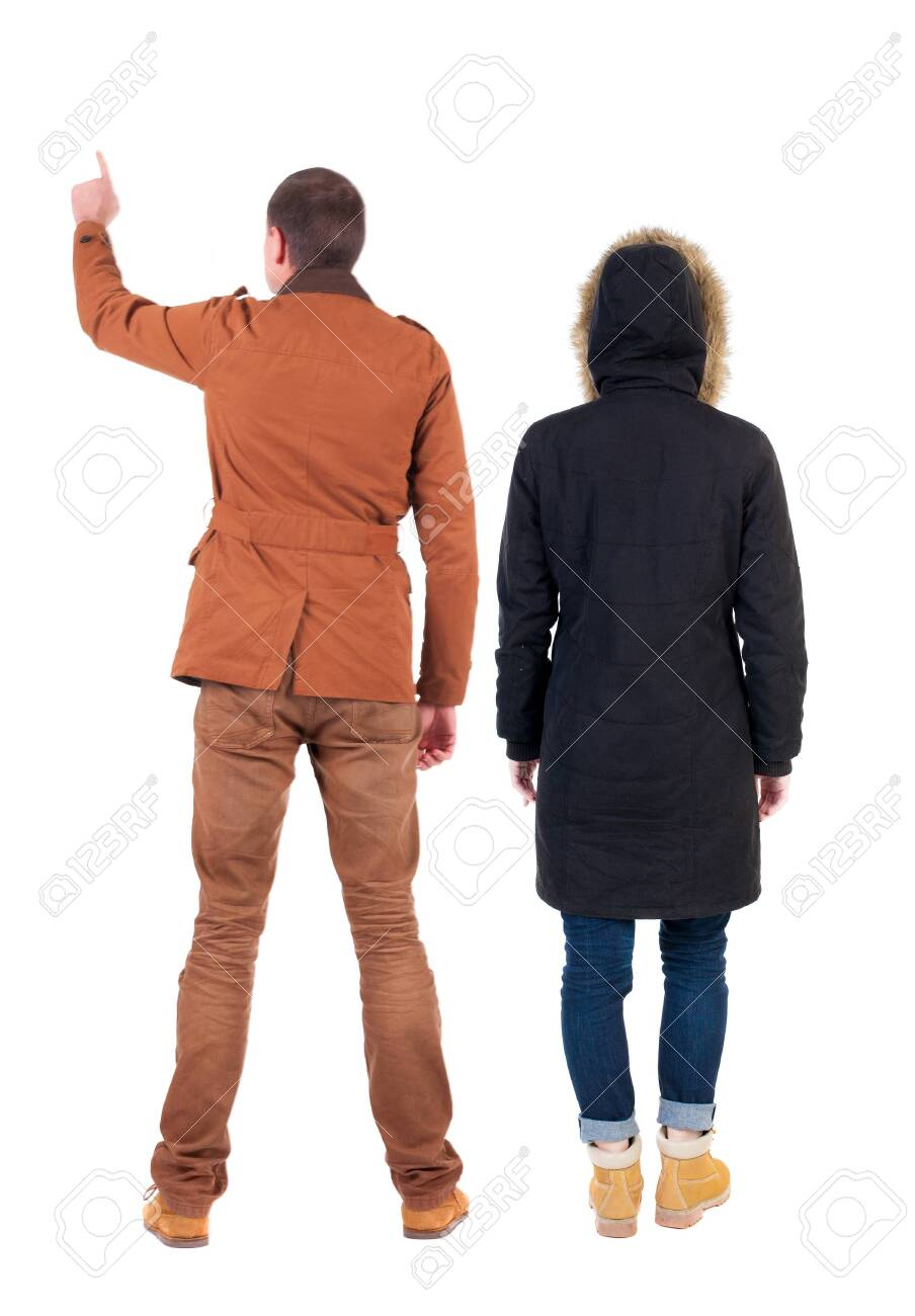Back view of couple couple in winter jackets pointing. beautiful friendly girl and guy together. Rear view people collection. backside view of person. Isolated over white background. - 135834212