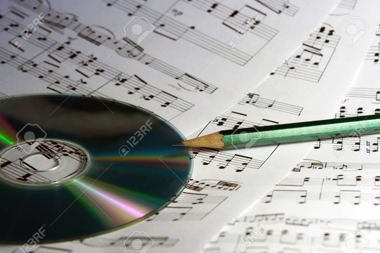 CD and dark - green pencil on three sheets of notes Stock Photo - 3904539
