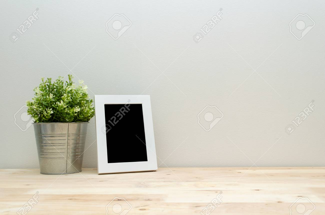 Blank Black Frame Mock Up White Picture Frame With Mini Leaf.. Stock ...