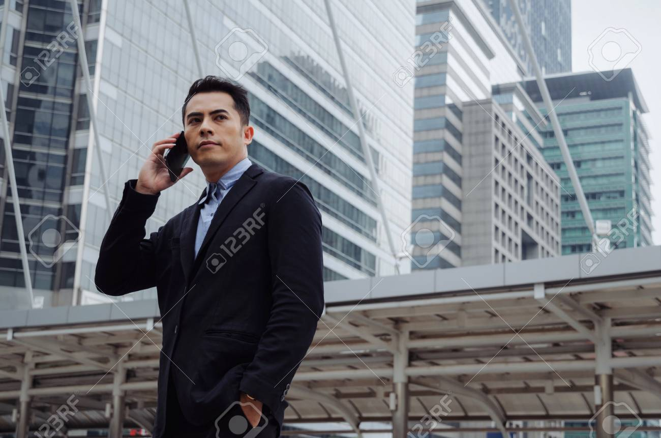 Young Smart Asian Business Man Wearing Modern Black Suit Making ...