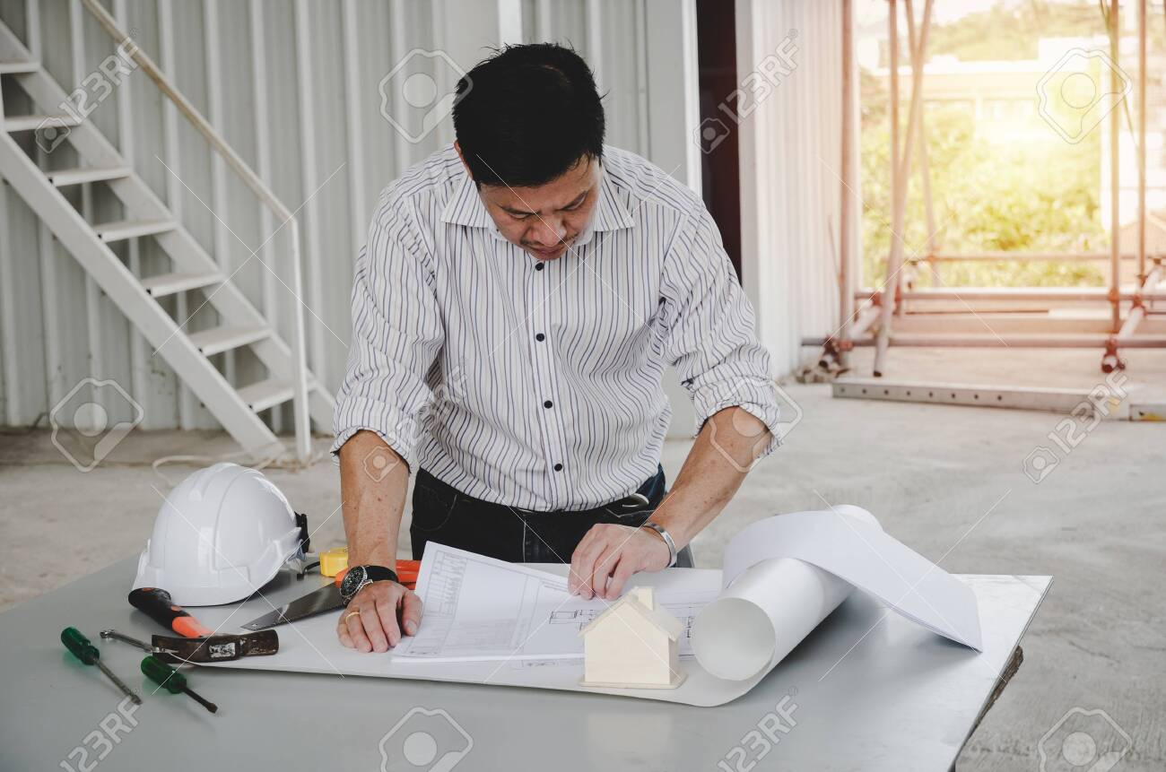 Professional Architect Engineer Or Interior Drawing With Blueprint